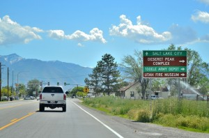 town of Grantsville, Utah, with a car driving away on a street